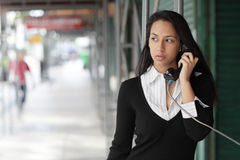 Woman on a pay phone Royalty Free Stock Photo