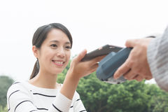 Woman pay on pos. Machine Royalty Free Stock Images