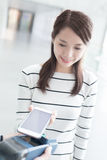 Woman pay by smart phone Royalty Free Stock Photography
