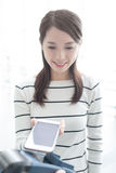 Woman pay by smart phone Stock Photos
