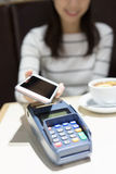 Woman pay by smart phone. Young woman pay by smart phone with empty screen in the restaurant, great for your design,asian beauty Stock Photo