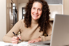 Woman paying bills stock photography