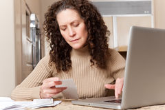 Woman paying bills royalty free stock photos