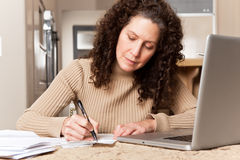 Woman paying bills royalty free stock images