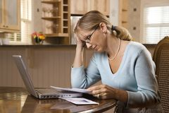 Woman paying bills Royalty Free Stock Photography