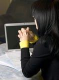Woman paying bills Stock Photos