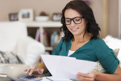 Woman paying bills Stock Photos