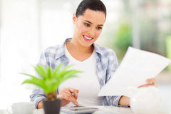 Woman paying bills Stock Image
