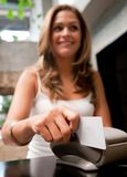 Woman paying by card Stock Photo