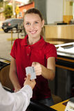 Woman paying cashier at the cash counter Royalty Free Stock Photos