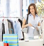 Woman paying at clothes shop Royalty Free Stock Photo