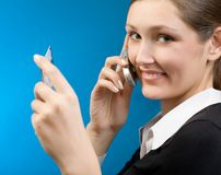 Woman paying with credit card by  cellphone. Young woman paying with credit card by  cellphone Royalty Free Stock Images