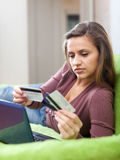 Woman paying by credit card in internet store Royalty Free Stock Image