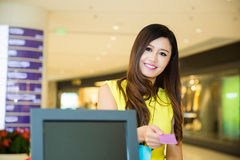 Woman Paying credit card for purchases Royalty Free Stock Image