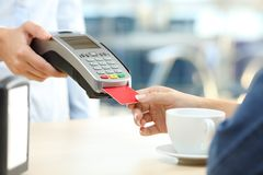 Woman paying with credit card reader in a bar Royalty Free Stock Images