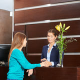 Woman paying with credt card hat hotel reception Royalty Free Stock Images