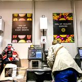 Woman Paying For Food Shopping At An Automated Till Point. Supermarkets Have Introduced Self-Scanning Tills to Save On Staff Costs. The British Retail Consortium stock photo