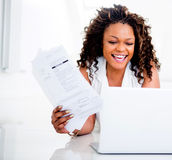 Woman paying her bills Royalty Free Stock Images