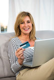 Woman paying on internet Stock Photography