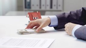 Woman paying money to realtor and taking house key. Business, real estate, deal and people concept - woman paying money to realtor and getting house keys stock video footage