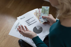 Woman paying off the loan Royalty Free Stock Photo