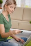 Woman paying online with credit card Royalty Free Stock Photography