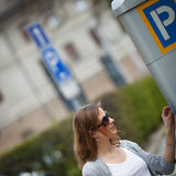 Woman paying for parking Royalty Free Stock Photos