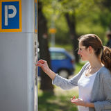 Woman paying for parking Stock Photos