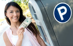 Woman paying for parking in cash Stock Photo