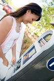 Woman paying for parking Royalty Free Stock Images