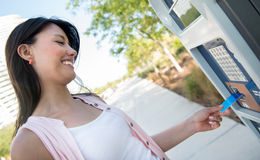 Woman paying for parking Royalty Free Stock Image