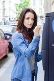 Woman paying parking fee. Park stock image