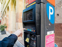 Woman paying for parking at the new Parking ticket payment machi Stock Images