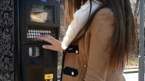 Woman paying for parking using terminal stock video footage
