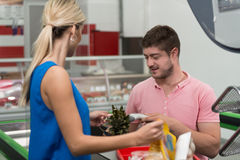 Woman Paying for Shopping at Checkout With Card. Woman at Cash Register Paying With Credit Card in Supermarket Royalty Free Stock Photo