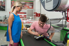 Woman Paying for Shopping at Checkout With Card. Woman at Cash Register Paying With Credit Card in Supermarket Royalty Free Stock Images