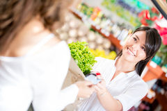 Woman paying at the supermarket Stock Images