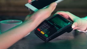 Woman is paying using the terminal and the phone. 4K. stock footage
