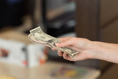 Woman pays cash for the breakfast in the cafe. Royalty Free Stock Images