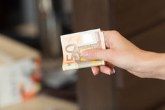 Woman pays cash for the breakfast in the cafe with euro banknotes Stock Image