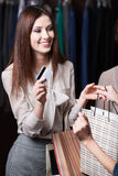 Woman pays with credit card for the purchase Stock Image