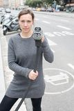 Woman pays at an electric car charging station stock photography