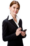 Woman With PDA. A young attractive businesswoman holding a handheld device on white background Stock Photos