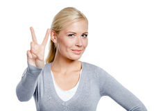 Woman peace gesturing Stock Image