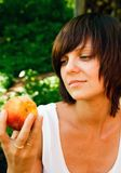 Woman and a Peach Stock Photography