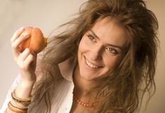 Woman with peach Royalty Free Stock Images