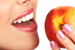 Woman with peach royalty free stock image