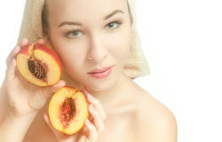 Woman with peach halves and a towel on her head. Woman with two halves of a peach and a towel on his head. Beauty. Horizontal photo royalty free stock photo