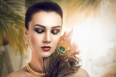 Woman with peacock feathers Stock Photos