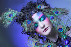 Woman in peacock image. Stock Photo